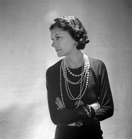 Coco Chanel wearing strands of faux pearls